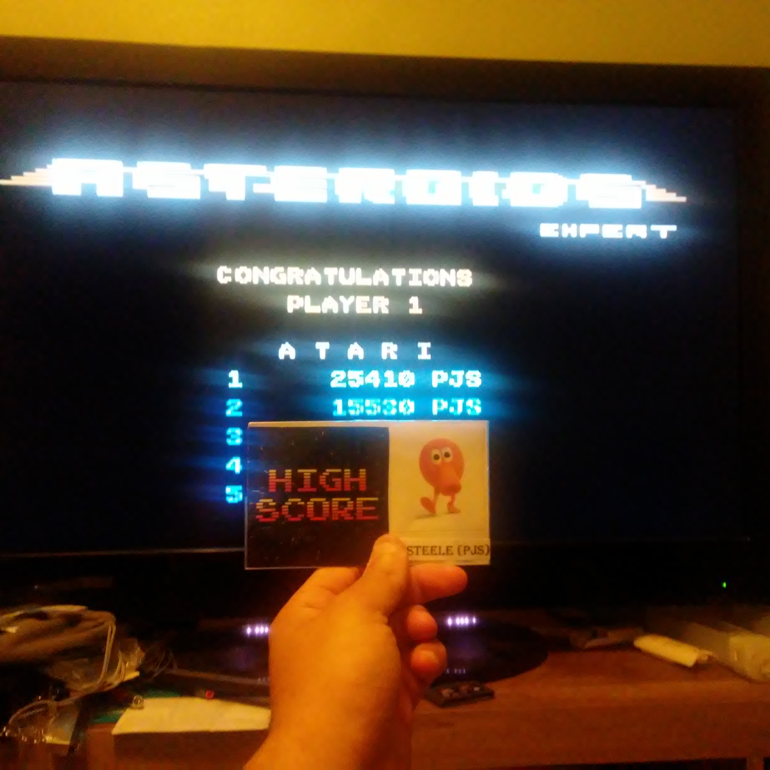 Pjsteele: Asteroids: Expert (Atari 7800 Emulated) 25,410 points on 2017-07-19 21:40:43