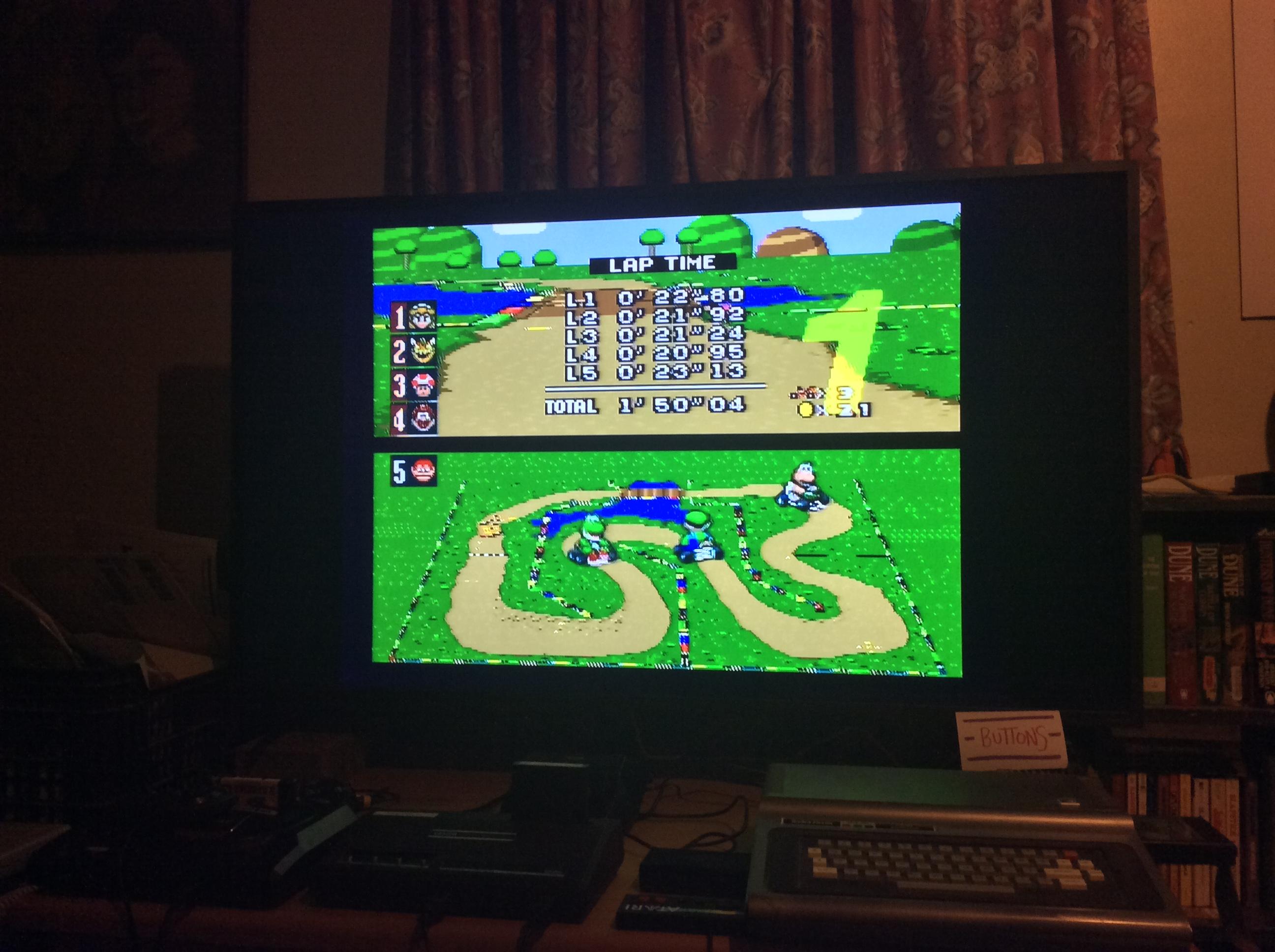 Super Mario Kart [Mushroom Cup: Donut Plains 1: 50CC] time of 0:01:50.04