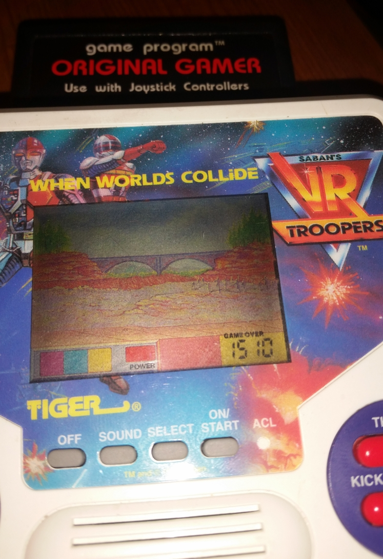 OriginalGamer: Tiger Electronics VR Troopers: When Worlds Collide (Dedicated Handheld) 1,510 points on 2016-05-27 18:44:43