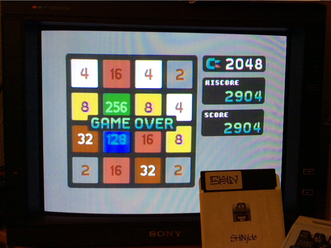 SHiNjide: C-2048 (Commodore 64) 2,904 points on 2014-12-13 03:29:55